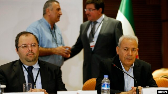 Mustafa Sabbagh (L), Secretary-General of the Syrian National Coalition, and  Burhan Ghalioun (R), former President of Syrian National Council, attend a meeting in Istanbul, Turkey, July 4, 2013.
