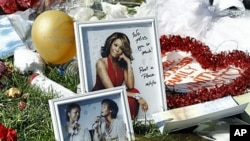 A makeshift memorial to Whitney Houston is seen in front of The Beverly Hilton hotel in Beverly Hills, California, February 17, 2012.