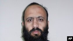 Hafiz Rashid, a senior leader of the al-Qaida-linked Haqqani network, poses for a picture in Kabul, Afghanistan, Oct. 15, 2014.