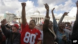 Football fans react during a Fan Rally event at Trafalgar Square in London, Saturday, Oct. 30, 2010, on the eve of an NFL football match between San Francisco 49ers and Denver Broncos at Wembley Stadium on Sunday.