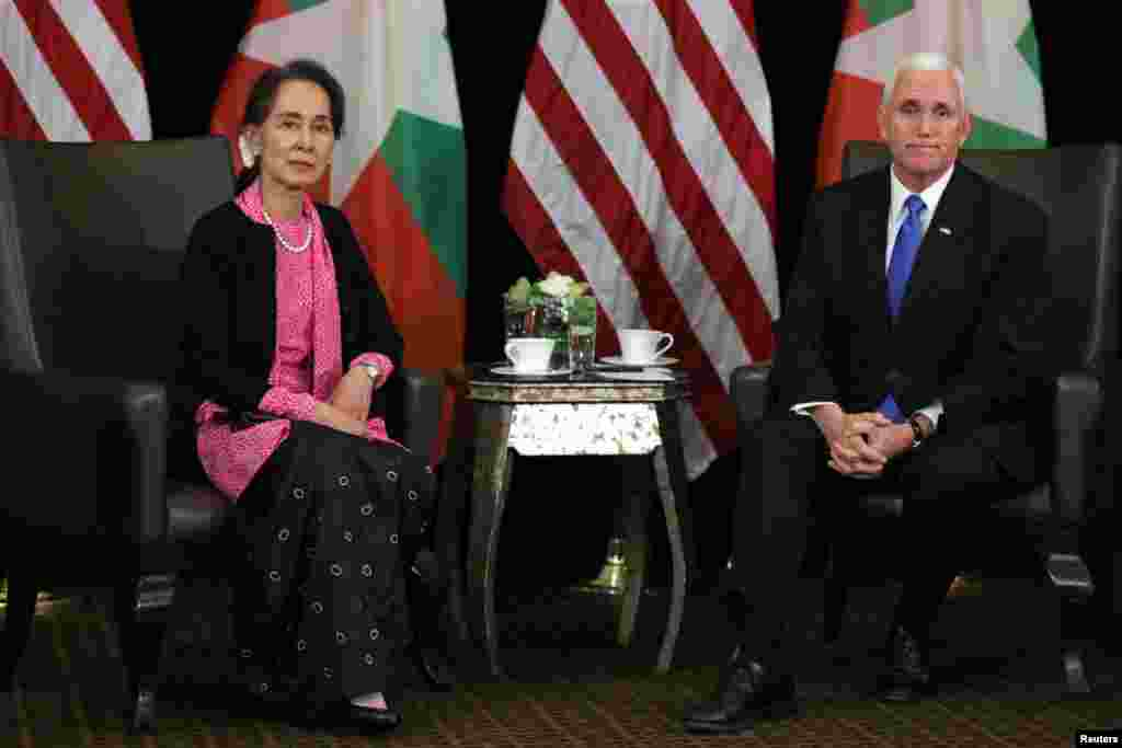 Myanmar's State Counselor Aung San Suu Kyi and U.S. Vice President Mike Pence meet in Singapore.
