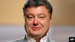 Kandidat presiden Ukraina Petro Poroshenko dalam sebuah jumpa pers di Kyiv, Ukraina (26/5).