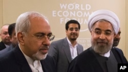 Iran's President Hassan Rouhani (r), and and his Foreign Minister Mohammad Javad Zarif, at the World Economic Forum in Davos, Jan. 22, 2014.