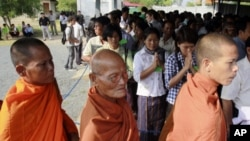 Cambodian Buddhist monks and villagers line up before the second trial to the top leaders of Khmer Rouge at the outside the court hall of the U.N.-backed war crimes tribunal. Now old and infirm, four of the top surviving members of the Khmer Rouge's rulin