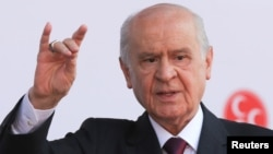 FILE - Devlet Bahceli, leader of Nationalist Movement Party (MHP), gestures as he attends his election rally in Ankara, Turkey, June 23, 2018.