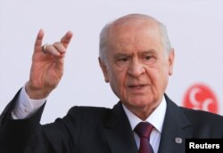 Devlet Bahceli, leader of Nationalist Movement Party (MHP), gestures as he attends his election rally in Ankara, Turkey, June 23, 2018.