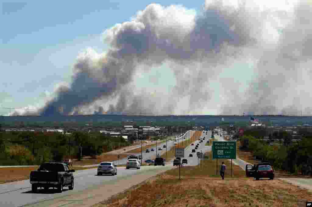 September 5: A series of large wildfires approaching Bastrop, Texas on Highway 71. (AP Photo/Erich Schlegel)