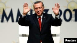 Turkey's Prime Minister Tayyip Erdogan greets members of the AK Party (AKP), which named him as its presidential candidate in Ankara, July 1, 2014.