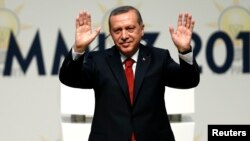 Turkey's Prime Minister Tayyip Erdogan greets AK Party (AKP) members at a meeting where he is named as his party's candidate for the country's first direct presidential election in Ankara, July 1, 2014.