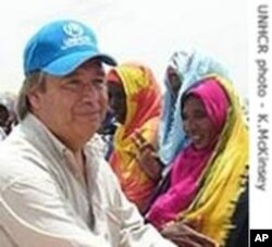 U.N. High Commissioner for Refugees Antonio Guterres greets refugees from Sudan.