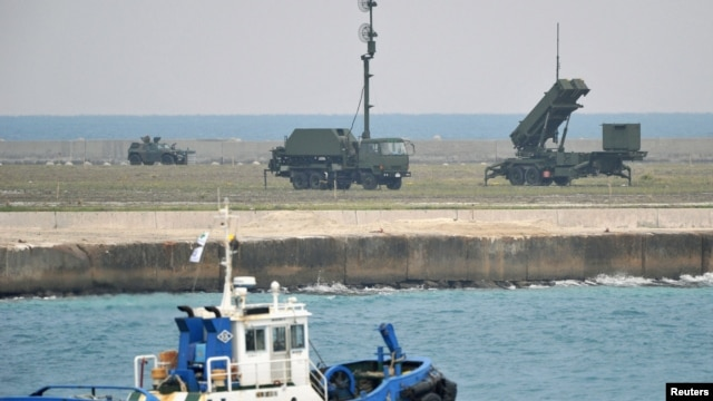 A Patriot Advanced Capability-3 missiles unit (R) is seen as a boat sails past in Ishigaki on Japan's southern island of Ishigaki Island, Okinawa prefecture, December 10, 2012.