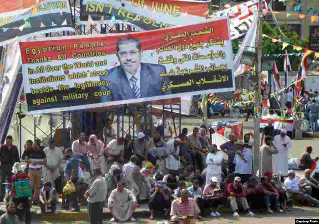 Pro-Morsi supporters in Muslim Brotherhood rallying point outside Rabaa al-Adawiya mosque in Cairo, July 11. Photo: VOA/Sharon Behn