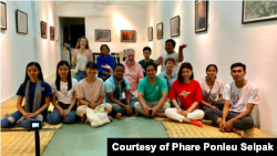 Srey Bandaul seen here with a group of artists and professionals at an exhibition in Phnom Penh. (Courtesy of Phare Ponleu Selapak)