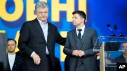 Ukrainian President Petro Poroshenko, left, and Ukrainian presidential candidate and popular comedian Volodymyr Zelenskiy attend debates at the Olympic stadium in Kiev, Ukraine, April 19, 2019.