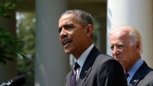 President Barack Obama, accompanied by Vice President Joe Biden, speaks in the Rose Garden of the White House in Washington, July 1, 2015.