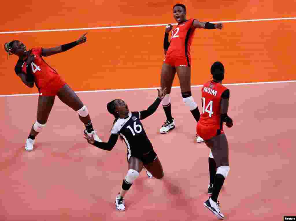 Leonida Kasaya of Kenya, Gladys Ekaru of Kenya and Agripina Kundu of Kenya celebrate during the Tokyo Olympics Volleyball - Women's Pool A South Korea v Kenya. REUTERS/Valentyn Ogirenko