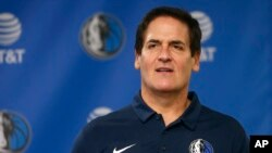 NBA's Dallas Mavericks owner Mark Cuban stands on stage ahead of a news conference, in Dallas, Texas, Feb. 26, 2018.