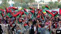 Libyans celebrate the liberation of Libya at Martyrs' Square in Tripoli, Libya, October 23, 2011.