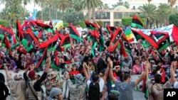 Libyans celebrate the liberation of Libya at Martyrs' Square in Tripoli, Libya, October 23, 2011.