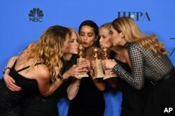 'Big Little Lies' cast at the Golden Globes in Beverly Hills, California with the award for best television limited series or motion picture made for television. (Photo by Jordan Strauss/Invision/AP)