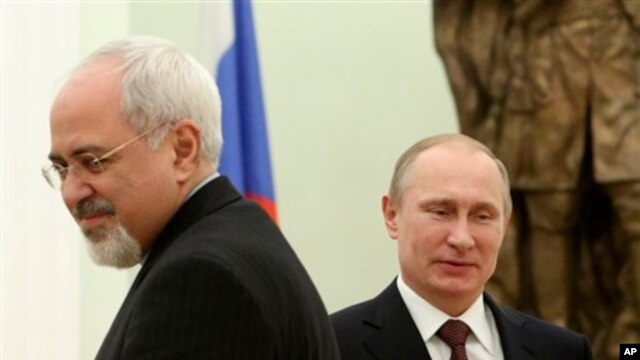 Russian President Vladimir Putin, right, and Iranian Foreign Minister Mohammad Javad Zarif, at the Kremlin in Moscow, Jan. 16, 2014.