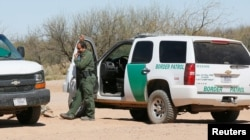U.S. Customs and Border Protection agents talk near the U.S.-Mexico border that crosses the Tohono O'odham reservation in Chukut Kuk, Arizona, April 6, 2017.
