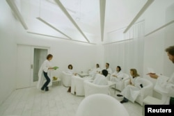 In Sweden, where lack of winter sunlight can contribute to depression, customers dressed in white robes take in simulated sunlight at Stockholm's Iglo Ljuscafe, Dec. 12, 2006.