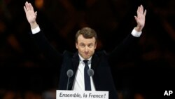 French President-elect Emmanuel Macron gestures during a victory celebration outside the Louvre museum in Paris, May 7, 2017.