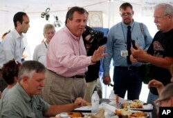 FILE - New Jersey Governor Chris Christie, one of 17 Republican presidential candidates, campaigns during a stop at a Greek festival in Manchester, N.H., Aug. 29, 2015.