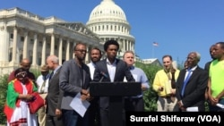 Feyisa Lelisa makes remarks in Washington, D.C., in September, 2016. The Olympic silver medalist from Ethiopia challenged Congress to recognize more freedoms are possible in his home country.