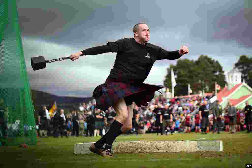 A competitor takes part in the Hammer Throw event at the annual Braemar Gathering in Braemar, central Scotland, Sept. 1, 2018.