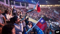 Evangelical Christians wave Taiwanese flags and another blows a shofar during a gathering in Jerusalem. Thousands of evangelical Christians from more than 80 countries descended upon Jerusalem this week to profess their love for the Jewish state, Sept. 29
