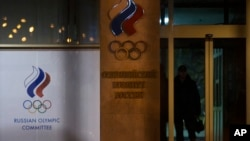FILE - A member of security guards a Russian Olympic committee building in Moscow, Russia, Monday, Nov. 9, 2015.