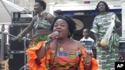 "Liberian singer Tokay Tomah entertains the crowd with one of her hit songs ""Chay-Chay Polay"""