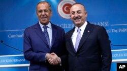 Сергей Лавров и Мевлюту Чавушоглу после совместной пресс-конференции в Анкаре, Турция, 14 августа 2018.
