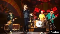 "British veteran rockers The Rolling Stones' singer Mick Jagger (C) sings during a concert on their ""Latin America Ole Tour"" at Morumbi stadium in Sao Paulo, Brazil, Feb. 27, 2016."