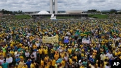 Thousands of demonstrators take part in a protest against the government of Brazil's President Dilma Rousseff, in front of the Brazilian National Congress, in Brasilia, Brazil, Sunday, March 15, 2015.