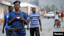 FILE - Burundi police patrol the streets in the capital Bujumbura after the results of the presidential elections were released, July 24, 2015.