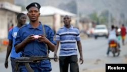 FILE - Burundi police patrol the streets of Musaga district in the capital, Bujumbura, after the results of the presidential elections were released, July 24, 2015.