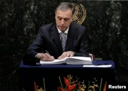FILE - Montenegro President Filip Vujanovic signs the Paris Agreement on climate change at the United Nations Headquarters in New York, April 22, 2016.