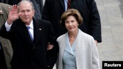 Former President of the United States George W. Bush and wife Laura Bus.