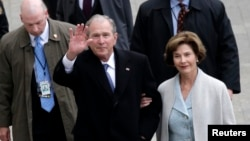 FILE - Former US President George W. Bush and wife Laura Bush arrive near the east front steps of the Capitol Building before President-elect Donald Trump is sworn in at the 58th Presidential Inauguration on Capitol Hill in Washington.