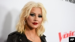 "FILE - Christina Aguilera arrives at Season 8 of ""The Voice"" Red Carpet Event in West Hollywood, California, April 23, 2015."
