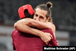FILE - In this Aug. 1, 2021, file photo, Gianmarco Tamberi, of Italy, embraces fellow gold medalist Mutaz Barshim, of Qatar, after the final of the men's high jump at the 2020 Summer Olympics in Tokyo.