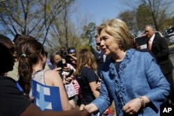 Democratic U.S. Presidential candidate Hillary Clinton talks to supporters during campaign stop outside of a polling station in Raleigh, North Carolina, March 15, 2016.