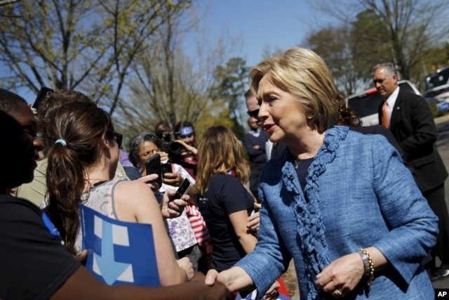 FILE - Democratic U.S. Presidential candidate Hillary Clinton talks to supporters during campaign stop outside of a polling station in Raleigh, North Carolina, March 15, 2016.
