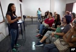 Marialbert Barrios speaks to a group of women at an empowerment workshop, in the Catia neighborhood of Caracas, Venezuela, Aug. 26, 2018.