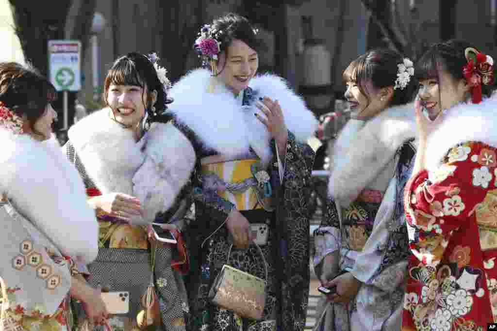 Kimono-clad women who celebrate their 20th birthday gather following a Coming of Age ceremony at Toshimaen amusement park in Tokyo, Japan, on Coming of Age Day.
