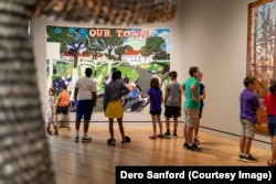 School children look at art at the Crystal bridges Museum of American Art, Bentonville, Arkansas