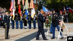 President Barack Obama lays a wreath at the Tomb of the Unknowns, on Veterans Day, Nov. 11, 2016, at Arlington National Cemetery in Arlington, Va.